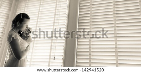 Beautiful woman and his chihuahua together in front of window - stock photo