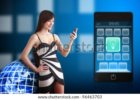 Beautiful woman and light bulb icon on mobile phone : Elements of this image furnished by NASA