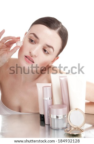 Beautiful woman applying  ice cube treatment on face. Skin care concept.  - stock photo