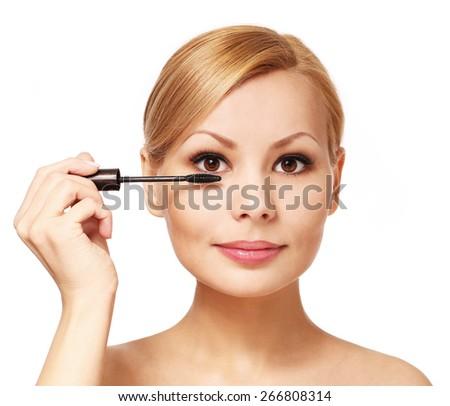 Beautiful woman applying mascara on her eyelashes, isolated. Blonde girl - stock photo