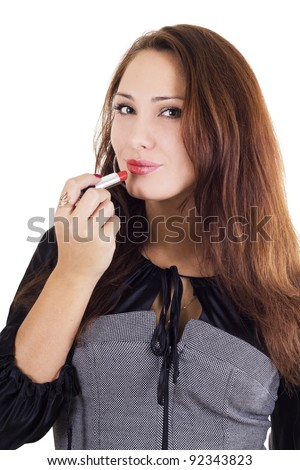 Beautiful woman applying red lipstick isolated on white - stock photo