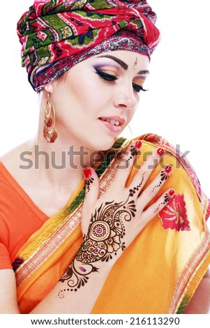 Beautiful woman arabian make up and turban on head with detail of henna being applied to hand isolated