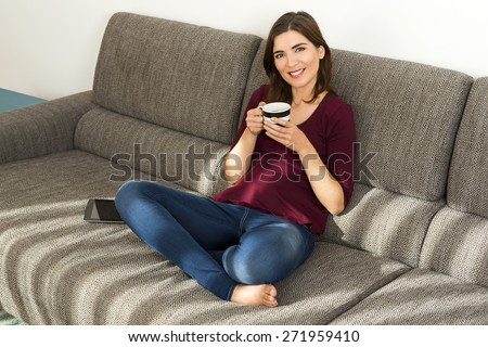 Beautiful woman at home relaxing after work - stock photo