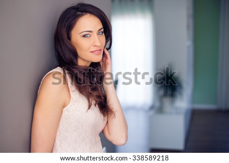 Beautiful woman at home smiling