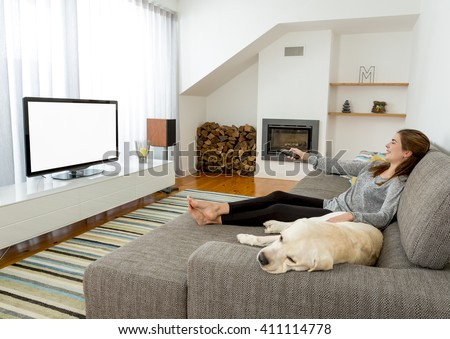 Beautiful woman at home with her best friends  - stock photo