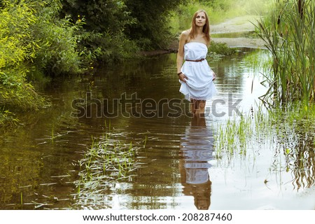 Beautiful woman at the river