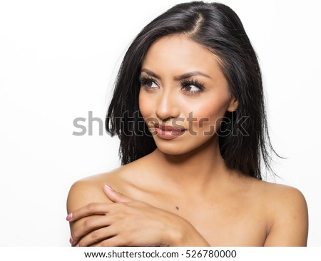 Beautiful woman bare shoulders looking to side