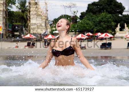 beautiful woman bathes at ocean