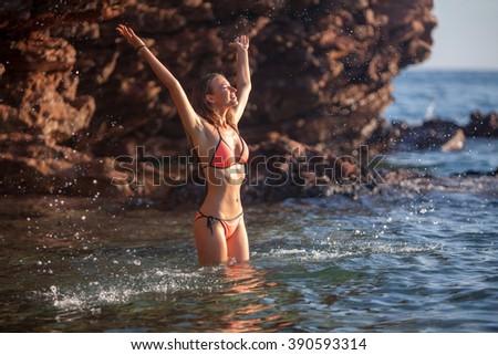 Beautiful woman bathing at sea - stock photo