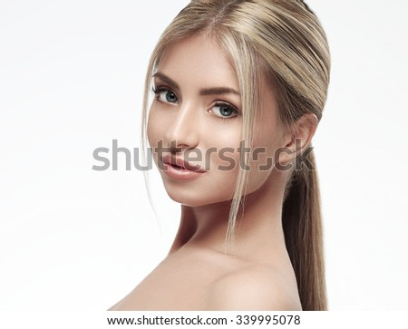 Beautiful woman blonde hair portrait close up studio on white