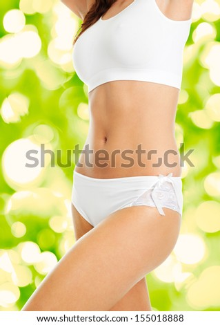 Beautiful woman body in white cotton underwear. Isolated on white - stock photo