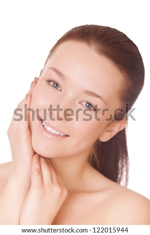 beautiful woman cares for face skin, isolated on white - stock photo