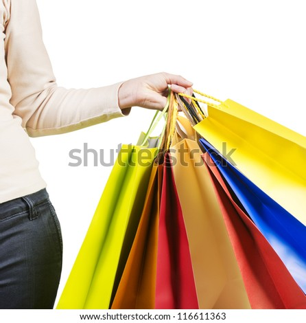Beautiful woman carrying a lot of colorful shopping bags close up