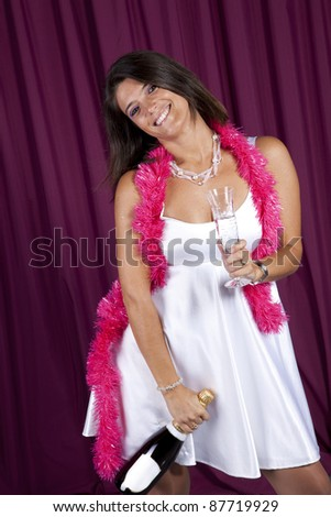 beautiful woman celebrating the new year eve with champagne - stock photo