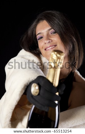 beautiful woman celebrating the new year eve with champagne (isolated on black) - stock photo