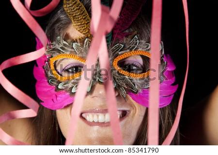 beautiful woman celebrating with a seductive mask - stock photo
