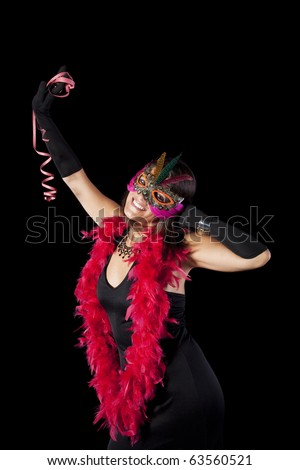beautiful woman celebrating with a seductive mask (isolated on black)