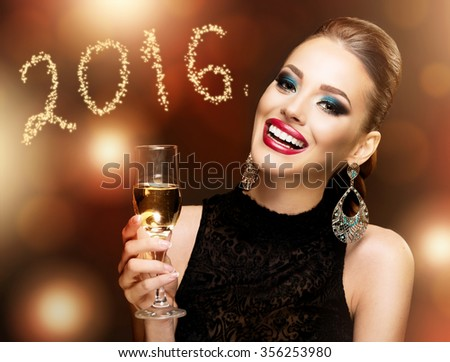 Beautiful woman celebrating with champagne; dark background with bokeh  - stock photo