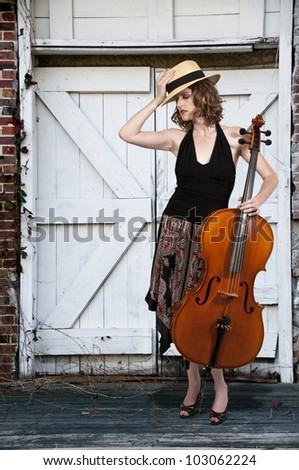 Beautiful woman cellist with her cello musical instrument - stock photo