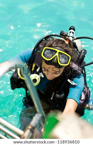 beautiful woman checking diving. dive equipment