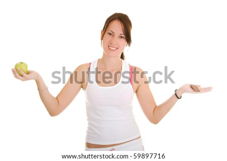 beautiful woman choosing between apple and chocolate on white background - stock photo