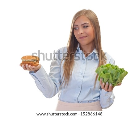 Beautiful woman choosing between  healthy food and  junk food