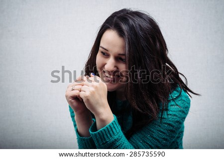 beautiful woman clasped hands in front of him - stock photo