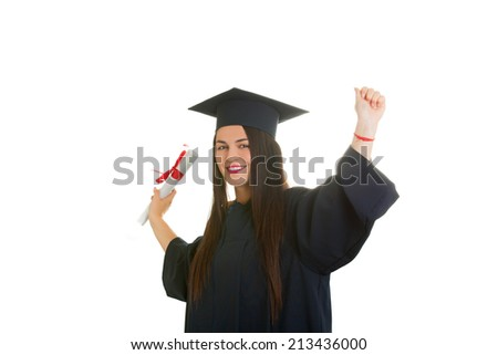 Beautiful woman college graduate wearing cap and gown holding diploma isolated on white background