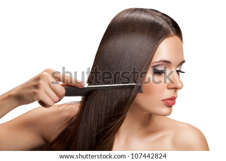 Beautiful Woman combs her  Healthy Long Hair.