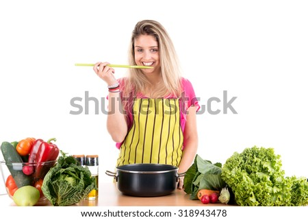 Beautiful woman cooking in the kitchen - stock photo