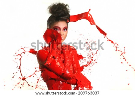 Beautiful Woman Covered in Bright Paint Splatter
