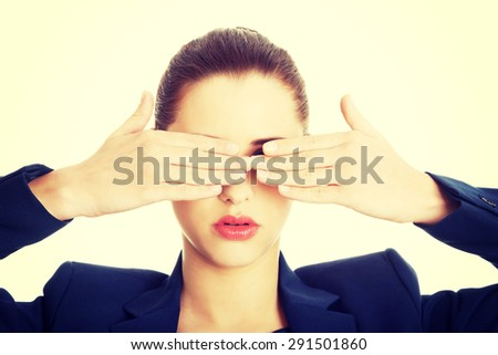Beautiful woman covering her eyes with her hands
