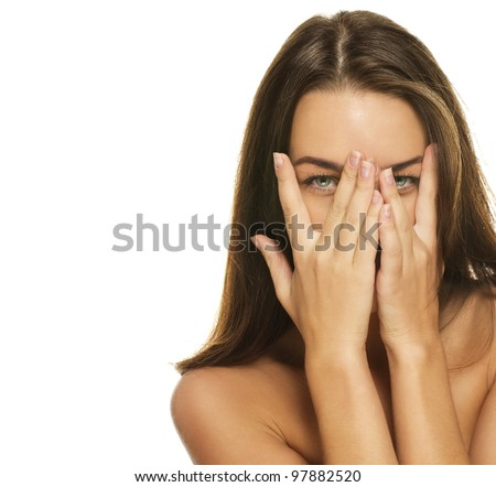 beautiful woman covering her face with her hands on white background - stock photo