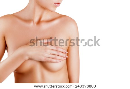 Beautiful woman covering her nude breast isolated on white background - stock photo