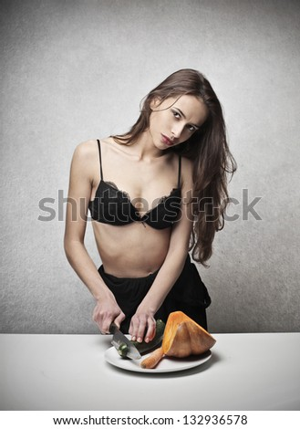 beautiful woman cuts vegetables - stock photo