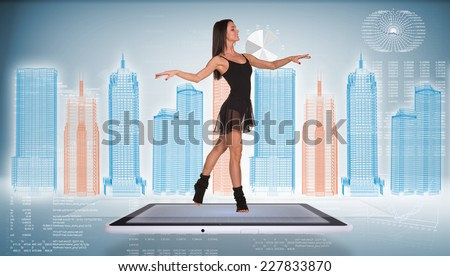 Beautiful woman dancer dancing on screen of tablet pc. Wire-frame business city and graphs as backdrop