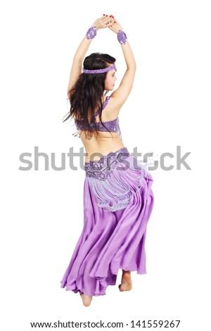 Beautiful woman dancing belly dance isolated on a white background