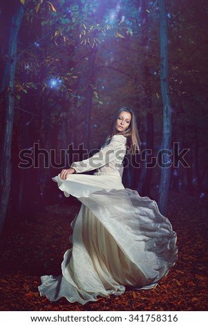 Beautiful woman dancing free forest fairies stock photo 341758316 beautiful woman dancing free with forest fairies surreal and fantasy voltagebd Images