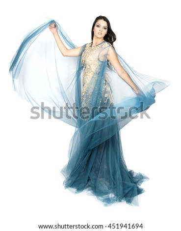 beautiful woman dancing in colorful dance costume.girl in an blue dress. beautiful brunette. long hair. - stock photo