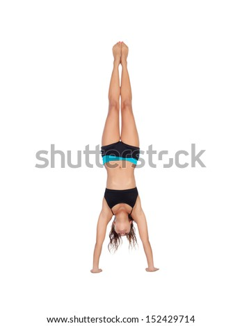 Beautiful woman do handstands isolated on a white background - stock photo