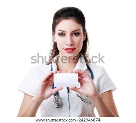 beautiful woman doctor holding empty card - stock photo