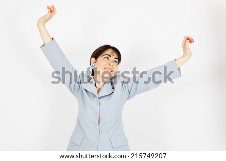 Beautiful woman doing different expressions in different sets of clothes: arms raised