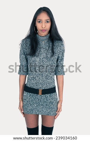 Beautiful woman doing different expressions in different sets of clothes: at attrntion - stock photo