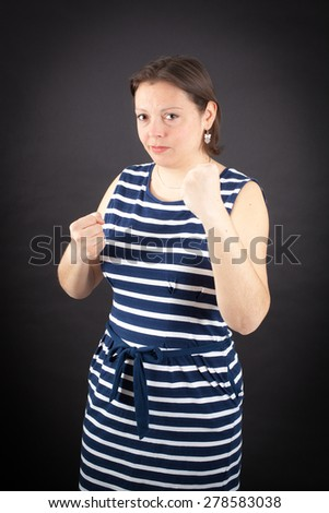 Beautiful woman doing different expressions in different sets of clothes: boxe - stock photo