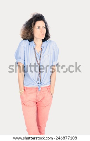 Beautiful woman doing different expressions in different sets of clothes: hands in pockets - stock photo