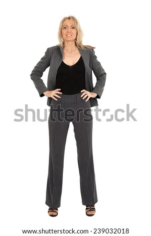 Beautiful woman doing different expressions in different sets of clothes: hands on hips - stock photo