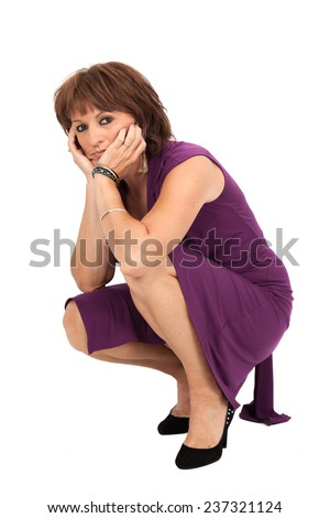 Beautiful woman doing different expressions in different sets of clothes: kneeling - stock photo