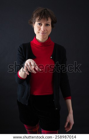 Beautiful woman doing different expressions in different sets of clothes: pointing