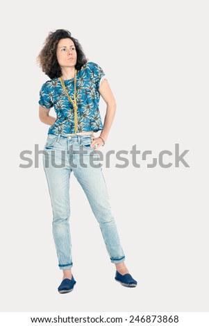 Beautiful woman doing different expressions in different sets of clothes: posing - stock photo