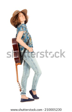 Beautiful woman doing different expressions in different sets of clothes: posing with a guitar